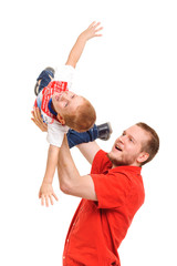 Fatherholding his son in hands, studio shot