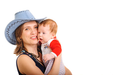 Mother holding her son and playing studio shot