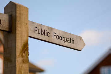 Public Footpath sign with direction arrow
