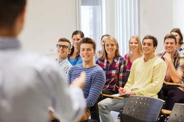group of students and teacher with notebook