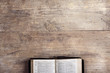 Bible on a wooden desk - 79096667