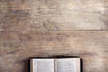"""Постер, картина, фотообои """"Bible on a wooden desk"""""""