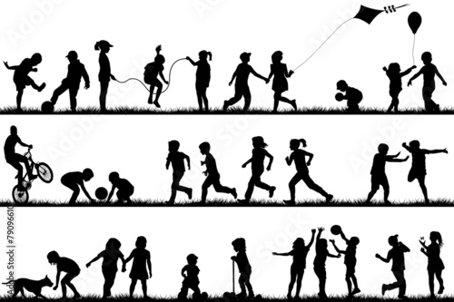 Children silhouettes playing outdoor - 79096610