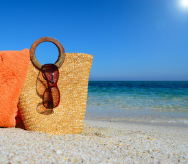 straw bag under the sun