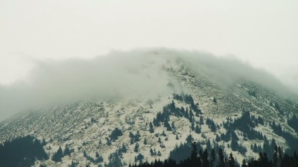Clouds moving over the top of the mountain. Timelapse