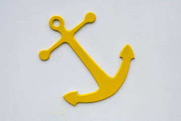 Yellow Anchor on white wall