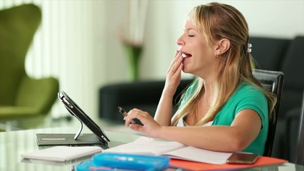 Young Woman Female Student Yawning While Studying