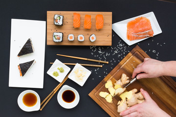 Cooking sushi top view with hands