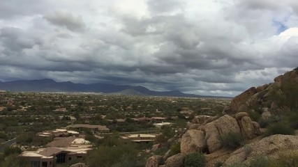 Timelapse clouds over mountain valley desert landscape