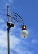 Lamp of city lighting against sky.