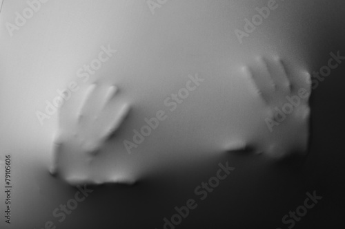 Human hands pressing through fabric as horror background - 79105606