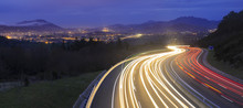"Постер, картина, фотообои ""car lights at night on the road going to the city"""