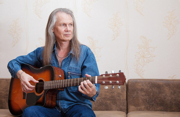 middle-aged man playing guitar