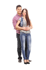 Cheerful young couple posing on white background