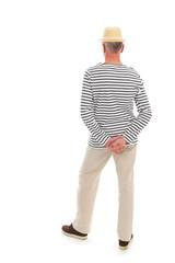 Senior man standing isolated over white background