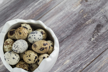 Small quail eggs wooden table dish