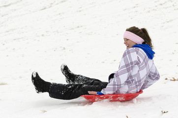 sledding on snow covered hill