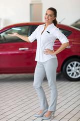 saleswoman presenting new car