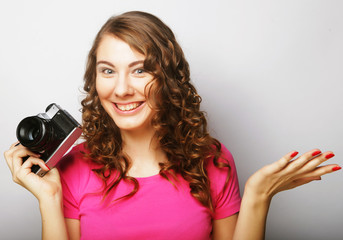 young woman with vintage camera