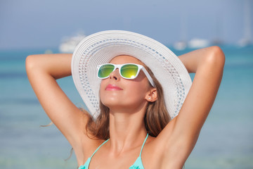 relaxed woman in sunshine on beach