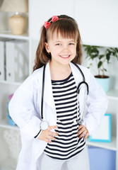 Little girl in doctor costume with stethoscope