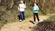 Senior couple in park jogging