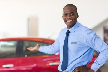 african car salesman presenting new cars