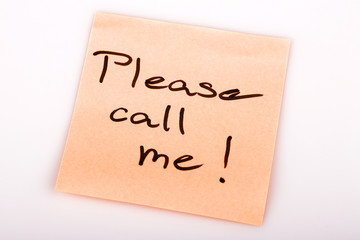 Please call me note on orange sticker note on white