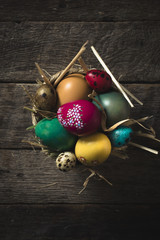 Group of Easter eggs on the basket on wooden background