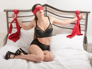 sexy woman tied to bed bondage