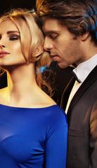 Handsome man seducing an elegant girl