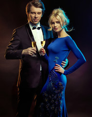 Portrait of an elegant couple with a champagne