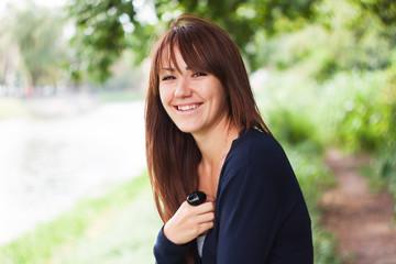 Beautiful girl laughs. Emotional portrait of brunette