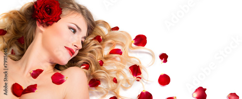 red petals rose in hairstyle and makeup