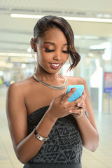 Young African American Woman Using Cell Phone