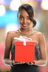 Woman Holding Gift Bow with Ribbon