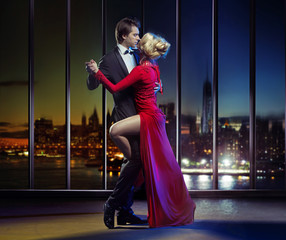 Couple dancing on the top of the skyscraper
