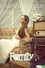 Young pregnant woman in retro style