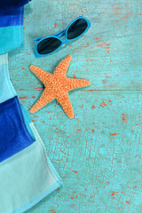 Summer Background with Beach Towel Starfish and Sunglasses