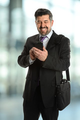 Mature Businessman Using Cellphone
