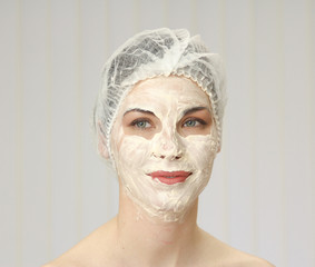 Relaxed woman with a face mask posing