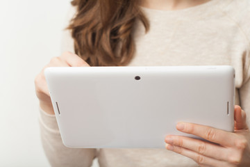 Close up young business woman holding tablet pc