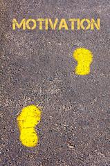 Yellow footsteps on sidewalk towards Motivation message