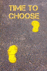 Yellow footsteps on sidewalk towards Time to Choose message