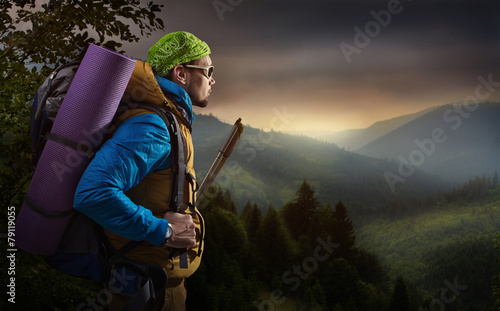 Adventure man hiking mountain - 79119055