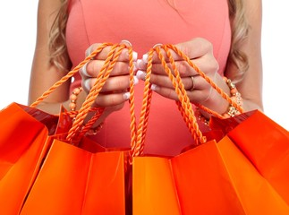 Woman hands with shopping bags.