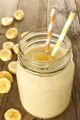 Banana oatmeal breakfast smoothie in mason jar on wood table