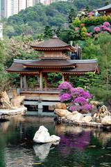 Pagoda in landscape and koi pond, Hong Kong