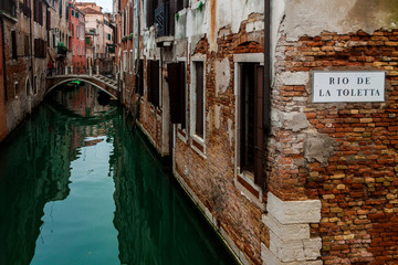 a romantic corner on a green canal in Venice
