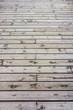 Wooden floor constructed from teak wood lumber planks for backgr